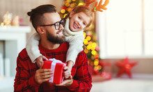 Happy Family Father And Child Daughter Giving Christmas Gift