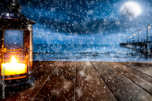 Foto auf Gartenposter Blaue Nacht Table background of free space and winter landscape with snowflakes.
