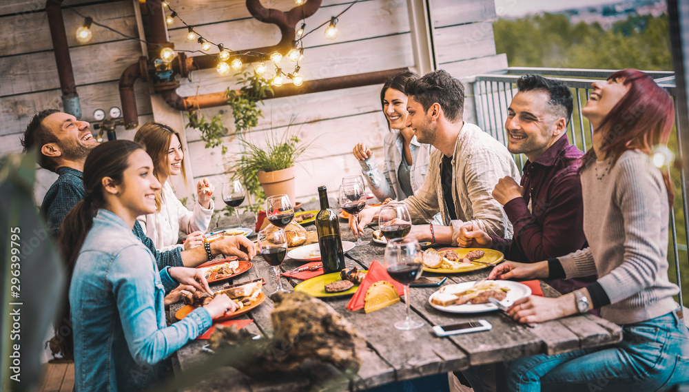 Fototapety, obrazy: Young people dining and having fun drinking red wine together on balcony rooftop dinner party - Happy friends eating bbq food at restaurant patio - Millannial life style concept on warm evening filter