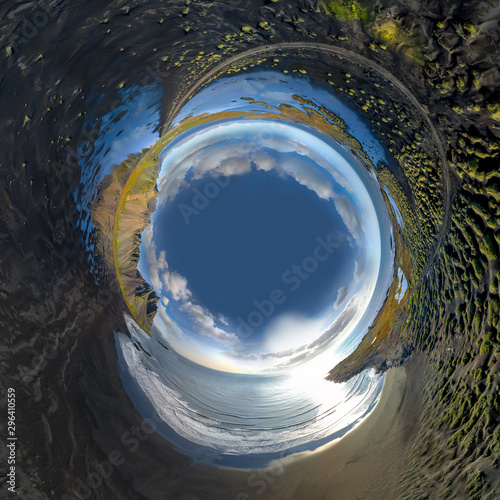 Inverted little planet of landscape of the black sand beach in Stokksnes on a sunny day Fototapet