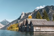 Lake Boathouse With A Mountain View To The Alps