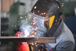canvas print picture - Welder is welding a metal frame.