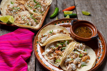 """Mexican Pork Tacos Also Called """"carnitas"""" On Wooden Background"""