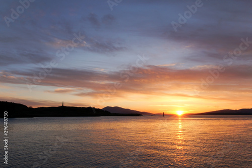 Sunset over Oban Bay and the entrance to Oban harbour Wallpaper Mural