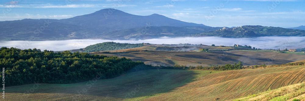 Beautiful foggy sunrise landscape in Tuscany, Italy