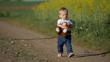 Lovely Baby Child Holding Tedd...