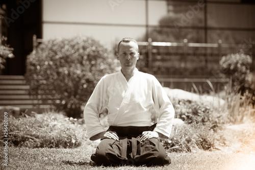 Aikido master wearing kimono with black belt Canvas Print