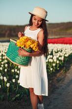 Happy Woman With Flowers Walki...