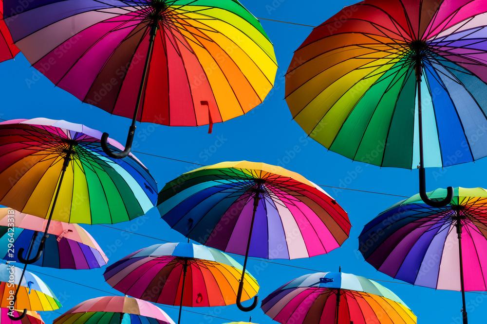 Fototapeta Many colorful umbrellas. Rainbow gay pride protection