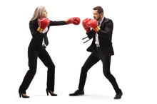 Businessman And Businesswoman In Sparring With Boxing Gloves