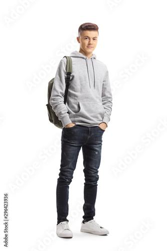 Teenage schoolboy posing with hands in pockets