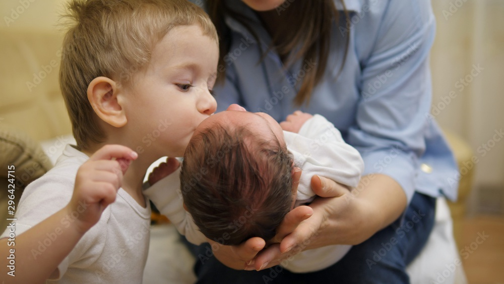 Fototapety, obrazy: Focus on newborn in mother arms, brother give a kiss to baby