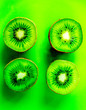 Leinwandbild Motiv healthy food with kiwi on green tropical background top view pattern