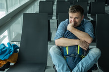 Young Man At The Airport Waiting For His Plane Looking At The Windoe
