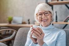Senior Woman Drinking Hot Drin...