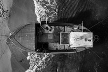 Aerial Photo Of Beach And Boat
