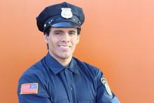 American Cop In Orange Backgro...