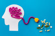 Brain charging and mental rest. Plug and cable leads to plastiline meanders on blue background top view copy space