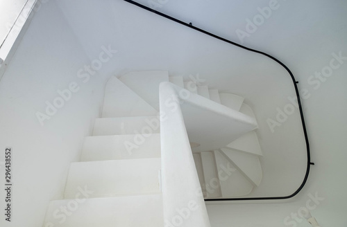 The white wall and ladder of Colombo Wallpaper Mural