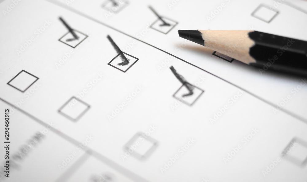 Fototapeta Black marking on checklist box with pencil close up. Checklist concept