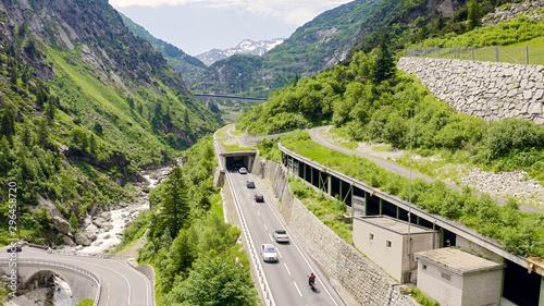 Montage in der Fensternische Pistazie Switzerland. Picturesque winding mountain road with tunnels Gotthardstrasse, Aerial View