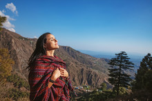 Beautiful Woman With Closed Eyes In Front Of Himalaya Mountains In Dharamshala, India