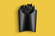 Painted In Black French Fries With Packing. Painted Food Concept Poster On Yellow. Black Friday Sale. Surrealism Of Food