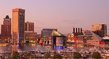Colorful Baltimore Skyline Over The Inner Harbor At Dusk, USA