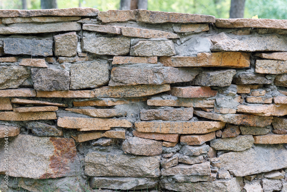 Natural facade stone decoration quartzite background texture. modern granite stone wall