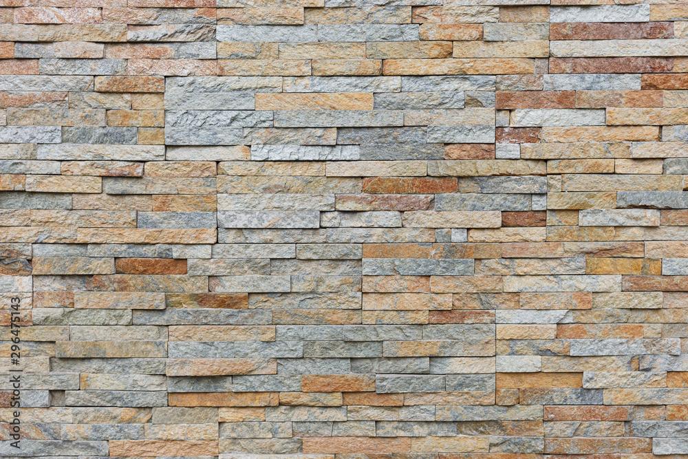 Fototapeta Natural facade stone decoration quartzite background texture. modern granite stone wall