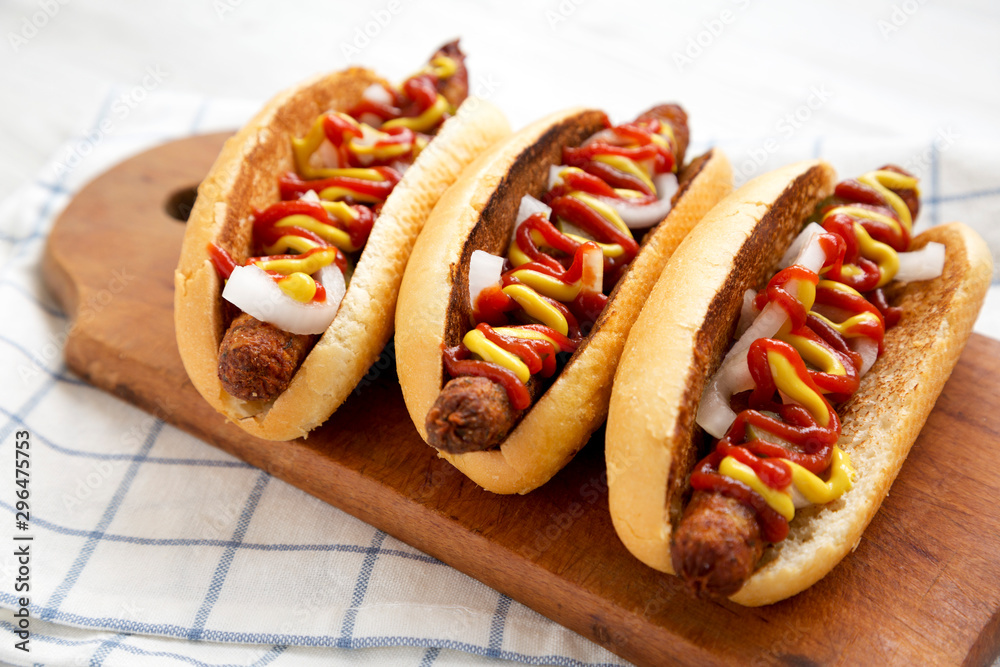 Fototapety, obrazy: Homemade hot-dogs with chicken sausage, ketchup and mustard on a rustic wooden board, low angle view. Close-up.