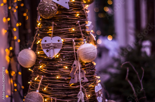 Arbre Christmas tree from wooden branches with ornaments and garlands