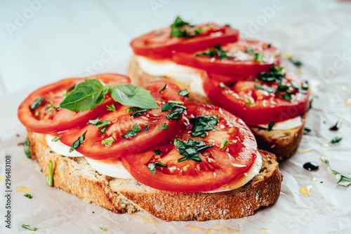Fotografía Caprese Toast With Mozzarella, Tomatoes And Basil