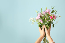 Female Hands With Bouquet Of Beautiful Flowers On Color Background