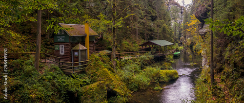 Montage in der Fensternische Forest river The Kamnitz Gorge - entrance (cabin, shed and boat) to the river port by the river flowing through rocky ravine in Bohemian Switzerland, Czech republic