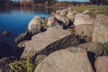 Large Stones On The Background Of The River In The Autumn Park