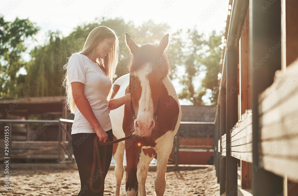 Fototapety, obrazy: Happy woman with her horse on the ranch at daytime