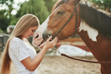 Hugging With Horse. Happy Woman On The Ranch At Daytime