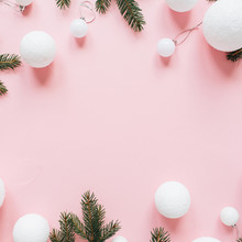 Christmas / New Year Holiday Composition. Mock Up Frame With Blank Copy Space Made Of Fir Needle Branches And Christmas Baubles On Pink Background. Flat Lay, Top View Festive Concept.