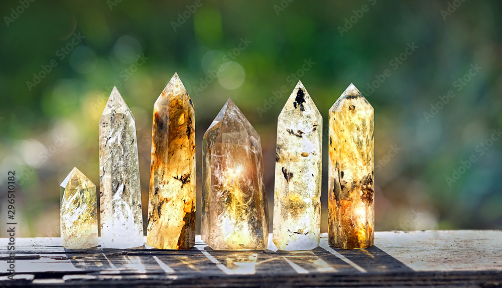 Fototapety, obrazy: quartz stones mineral. beautiful gemstones crystal on abstract blurred nature background. gems for relaxation, quartz crystals. Crystal Ritual, Witchcraft Crystal. copy space