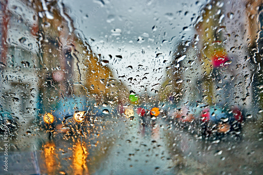 Fototapeta Car driving in rain and storm abstract background