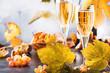 Leinwandbild Motiv Champagne wine in glass background. Autumn still life, wine tasting table setting concept
