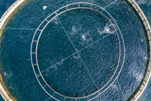 Bird's Eye View Of A Fish Pen In The Ocean Used For Fish Aquaculture Farming
