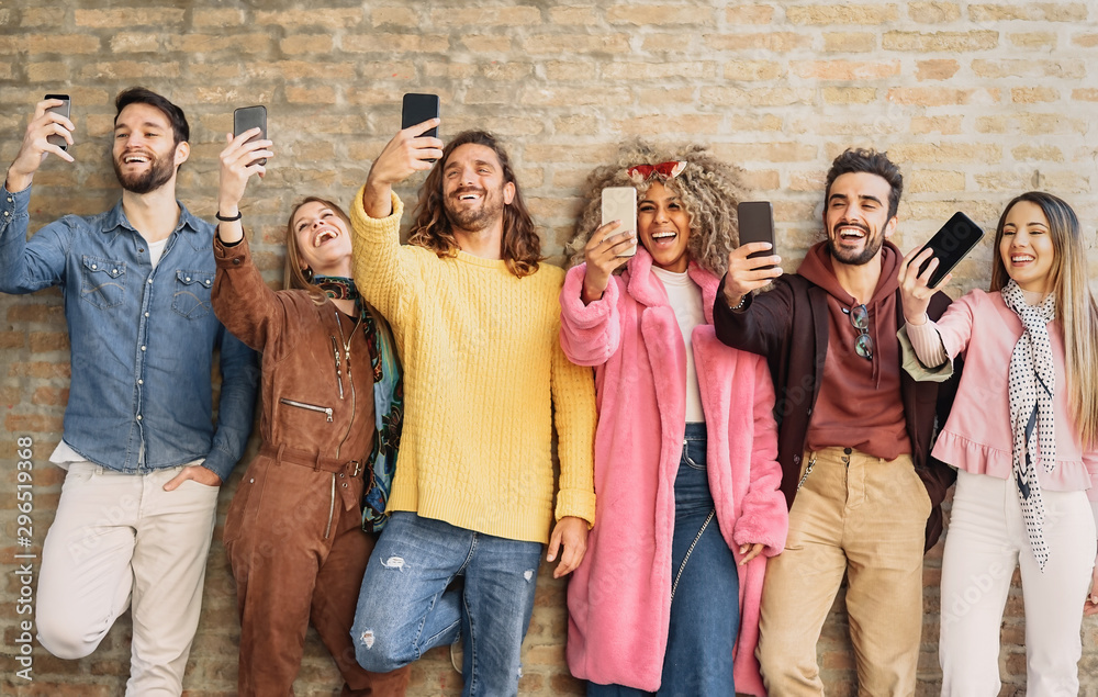 Fototapety, obrazy: Happy group friends taking selfie with cell phone outdoor - Young trendy people having fun with new mobile smartphone apps for social media - Youth culture millennial generation and Technology concept