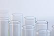 Leinwandbild Motiv close up view of glass test tubes isolated on white