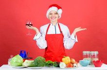 Woman Chef Cooking Christmas Dinner Wear Santa Hat. Best Christmas Recipes. Enjoy Easy Ideas For Holiday Parties And Holiday Dinners. Festive Menu Concept. Christmas Dinner Ideas. Christmas Menu