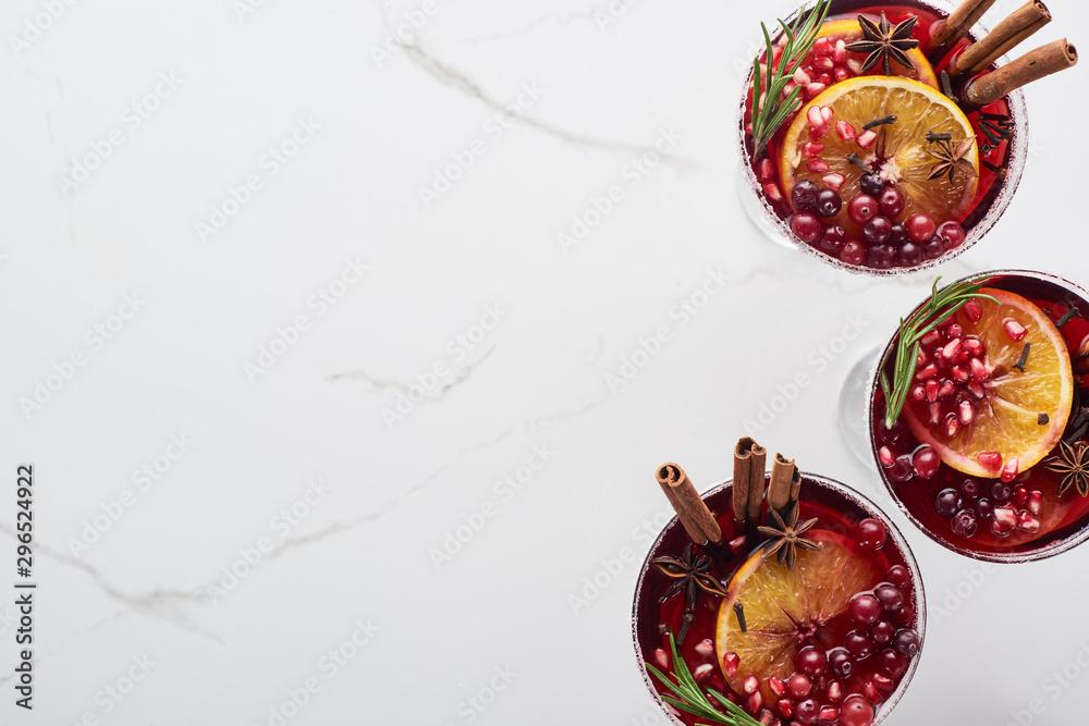 Fototapeta top view of christmas cocktails with orange, pomegranate, cinnamon
