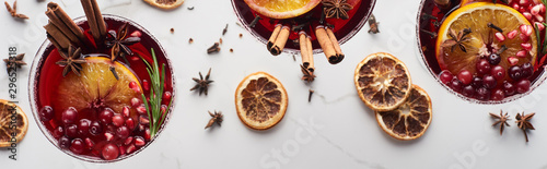 Fototapeta panoramic shot of christmas cocktails with orange, pomegranate, cinnamon obraz