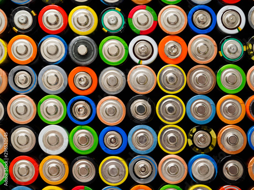 Photo A large number of old AA batteries of different colors