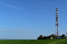 Telecommunication Tower With Radio Antennas In A Green Environment. Electromagnetic And Microwaves Background/pollution.